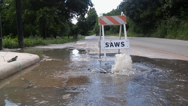 Sewage flows out of a manhole on Holbrook Road. - MICHAEL MARKS