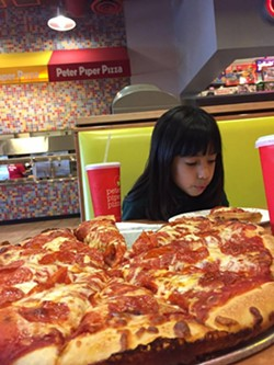 No, really, she loves pizza. - COURTESY