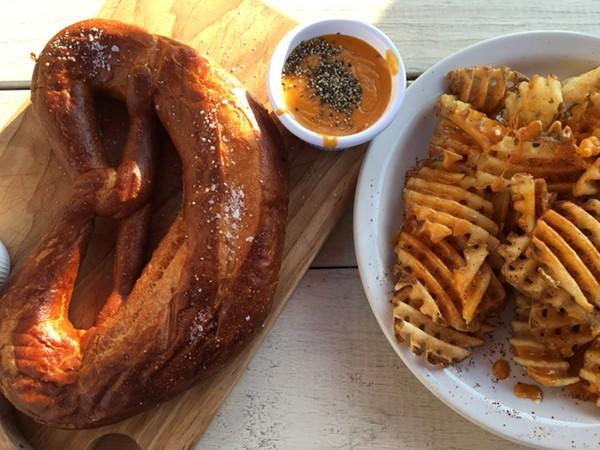 Frank's giant pretzel and cheese fries. - JESSICA ELIZARRARAS