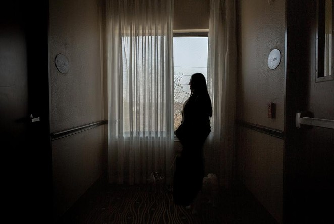 Lisa, an anonymous HPV patient living in a Houston hotel to escape domestic abuse, navigates the uncertainties of Planned Parenthood being withdrawn from Medicaid coverage. - BRIANA VARGAS / THE TEXAS TRIBUNE