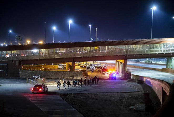 U.S. Customs and Border Protection agents escorted a group of migrants near the Paso del Norte International Bridge in El Paso in 2019. - IVAN PIERRE AGUIRRE / THE TEXAS TRIBUNE