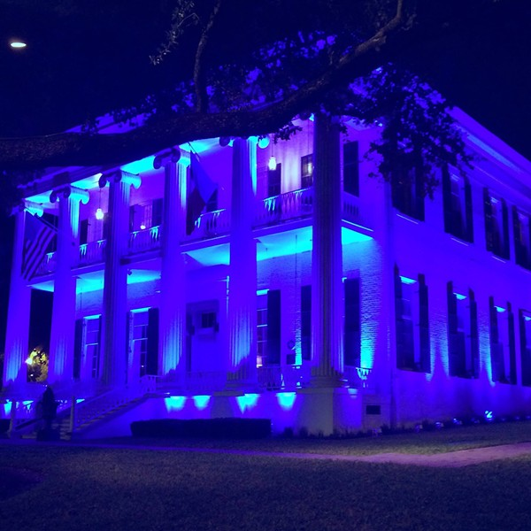 Blue lights illuminated the Texas Governor's Mansion earlier this month in remembrance of five Dallas police officers killed by a shooter who targeted law enforcement. - GOVERNOR GREG ABBOTT | FACEBOOK