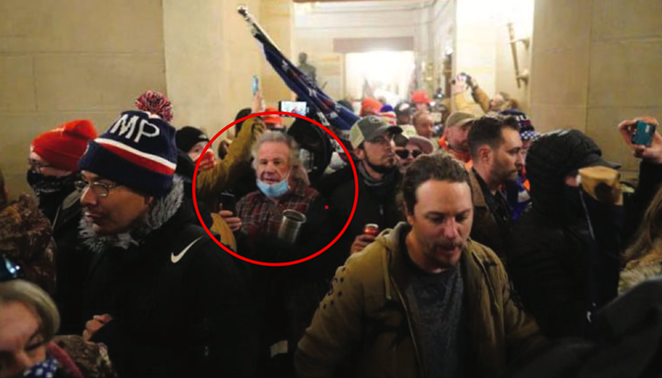 "This photograph the FBI obtained from CNN appears to show James ""Sonny"" Uptmore inside the U.S. Capitol on January 6. He is circled in the image. - FBI"