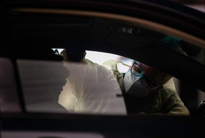 A nurse conducts a swab test for COVID-19 on a patient in a drive-thru station at the Austin Emergency Center at Mueller on Jan. 25, 2021. Since the fall, the CDC says there have been several new variants identified worldwide: A UK variant (B.1.1.7), a South African variant (B1.351) and a Brazilian variant (P.1). - EVAN L'ROY / THE TEXAS TRIBUNE