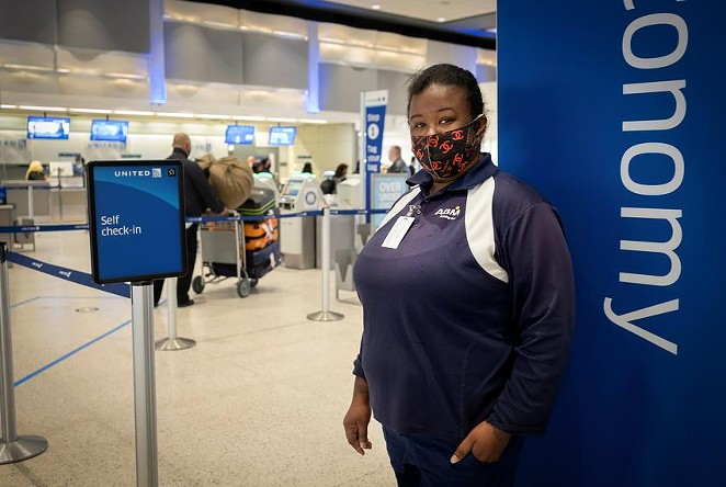 Monique Warren works as a baggage handler at George Bush Intercontinental Airport in Houston. Warren earns $9 per hour, and is a supporter of President Joe Biden's proposal to raise the minimum wage to $15 an hour. - MAY-YING LAM / THE TEXAS TRIBUNE