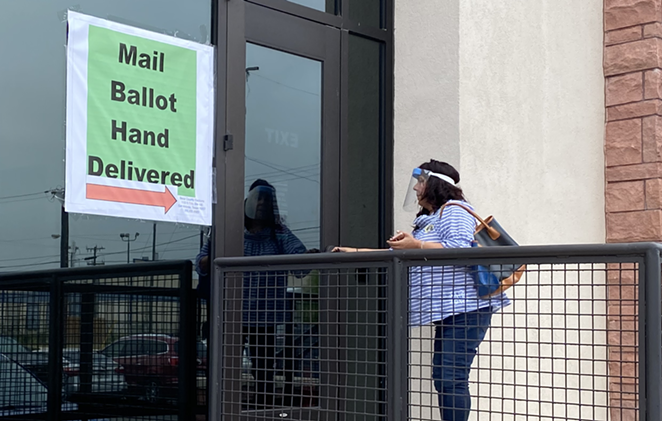 A voter drops off her ballot at the Bexar County Elections Office. - SANFORD NOWLIN
