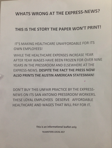 Press workers at the Express-News handed out this flier around the daily's downtown building Wednesday morning