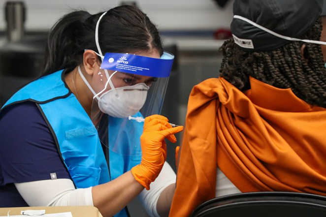 A woman receives her COVID-19 vaccination at the Alamodome. - COURTESY / CITY OF SAN ANTONIO