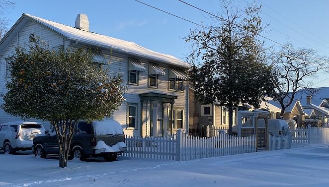 Snow blankets a neighborhood north of downtown San Antonio. - SANFORD NOWLIN