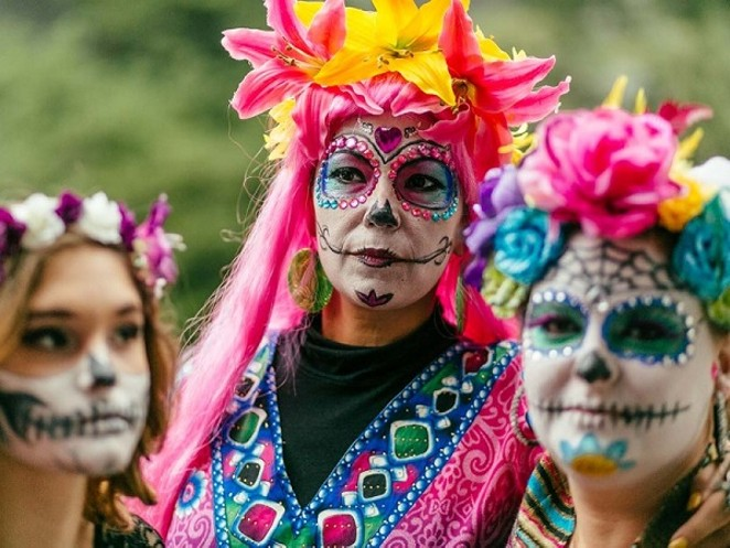 Decked out revelers at Muertos Fest. - PHOTO CREDIT: JOSH HUSKIN