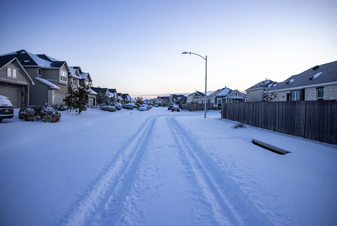 """The Blanco Vista neighborhood of San Marcos was blanketed with several inches of snow as a massive winter weather system caused power outages across Texas. As Texas utility operators and politicians squabbled over responsibility for """"load shedding"""" and """"rolling blackouts"""" Tuesday, many residents scrambled simply to stay warm and alive. - JORDAN VONDERHAAR FOR THE TEXAS TRIBUNE"""