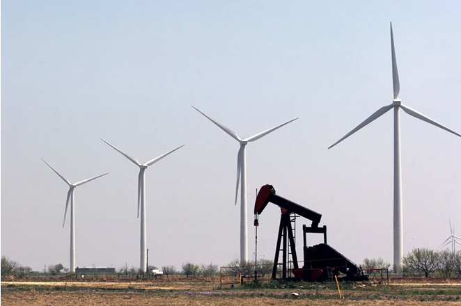 A working pump jack on the Cline Shale sits among wind turbines that cover the landscape south of Sweetwater. - MARK GRAHAM FOR THE TEXAS TRIBUNE