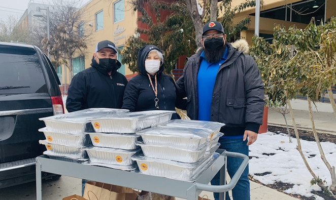 Torchy's Tacos Medical Center location Managing Partner Joe Joyer rallied with staff to deliver 400 tacos to the Haven for Hope staff. - COURTESY TORCHY'S TACOS