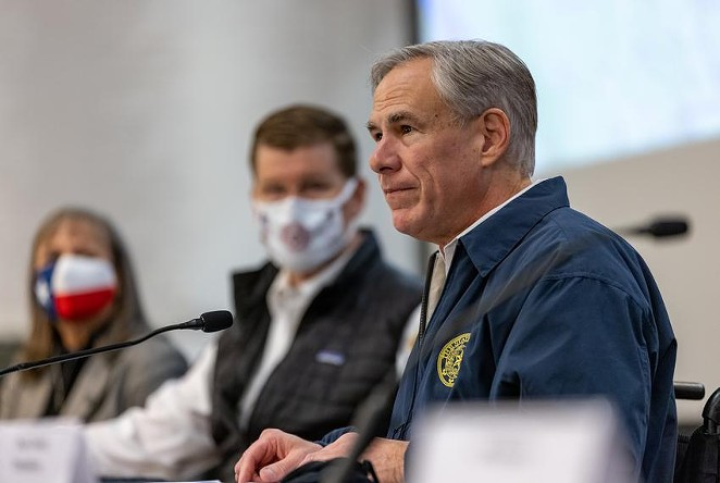 Gov. Greg Abbott speaks at a press conference regarding Texas' emergency response to an unprecedented winter storm gripping Texas on Feb. 13, 2021. Abbott himself might not have been paying close attention to electricity and water and gas a couple of weeks ago, but the people who are paid to pay attention report to him. Credit: - JORDAN VONDERHAAR / THE TEXAS TRIBUNE