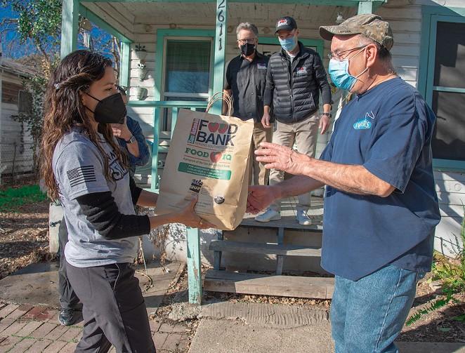 Eva Longoria helps with a San Antonio food distribution. - COURTESY / SAN ANTONIO FOOD BANK
