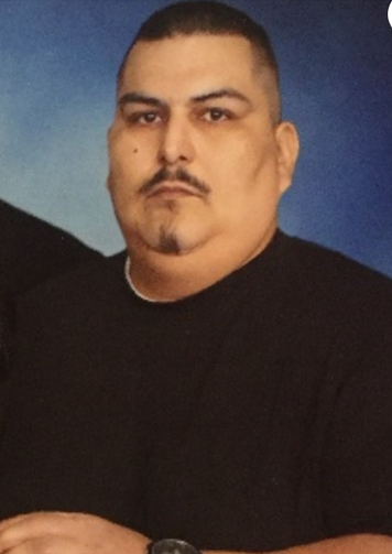 Police say Isidro Zarate was shot and killed when he told a man to stop beating a woman in a Walmart parking lot