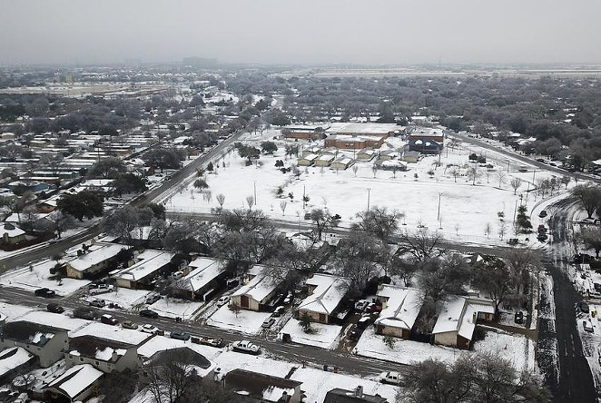 A severe snowstorm dumped heavy snow across the state last month, including on the Dove Springs neighborhood in South Austin. - MIGUEL GUTIERREZ JR. / THE TEXAS TRIBUNE