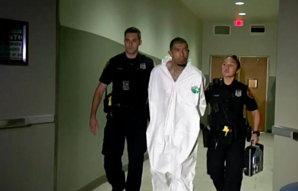 SAPD officers escort Capital Murder suspect Jason Prieto into a police car. - FOX SAN ANTONIO