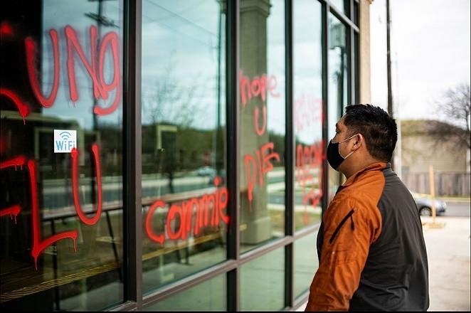 Noodle Tree owner Mike Nguyen surveys the vandalism to his restaurant on Sunday. - INSTAGRAM / @NOODLETREETX
