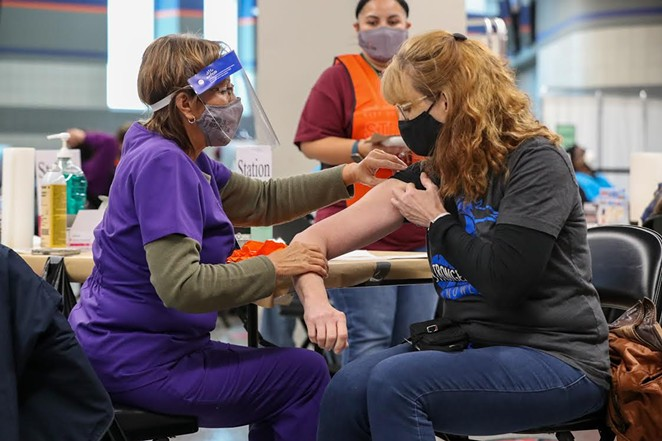 A San Antonio resident receives her shot at the Alamodome mass-vaccination site. - COURTESY PHOTO / CITY OF SAN ANTONIO