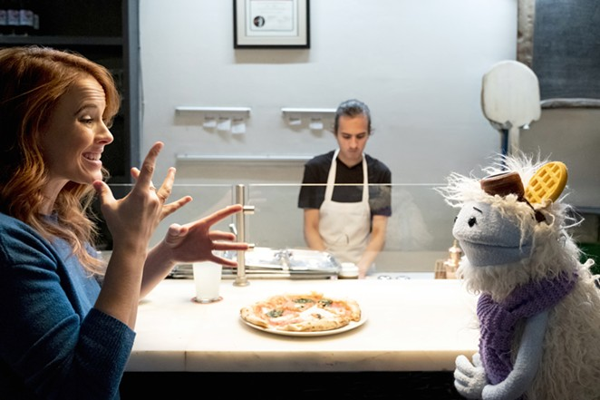 Katie Leclerc shares a scene with the show's titular puppet Waffles. - NETFLIX