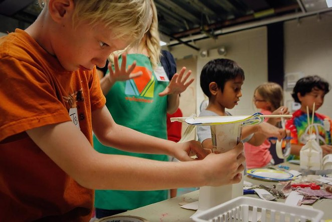 James Miller, 9, finishes his kinetic energy project during Secret Scientists summer camp at the Austin Children's Museum. The COVID-19 tests will be voluntary for both staff and campers. - ERICH SCHLEGEL / THE TEXAS TRIBUNE