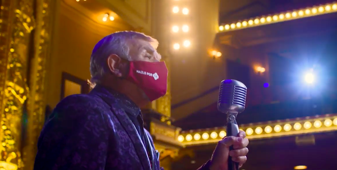 Tejano singer Little Joe delivers his message with a mask on. - YOUTUBE SCREEN CAPTURE / CITY OF SAN ANTONIO