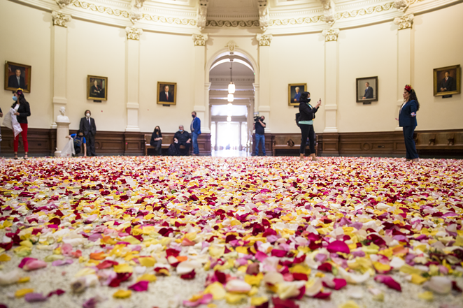 Young voting-rights activists dumped thousands of multicolored rose petals into the Capitol rotunda Thursday. - COURTESY PHOTO / JOLT ACTION