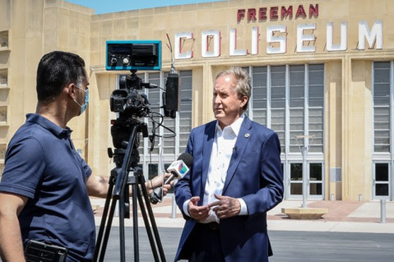 Texas AG Ken Paxton enjoys some camera time in front of Freeman Coliseum. - COURTESY PHOTO / TEXAS ATTORNEY GENERAL'S OFFICE