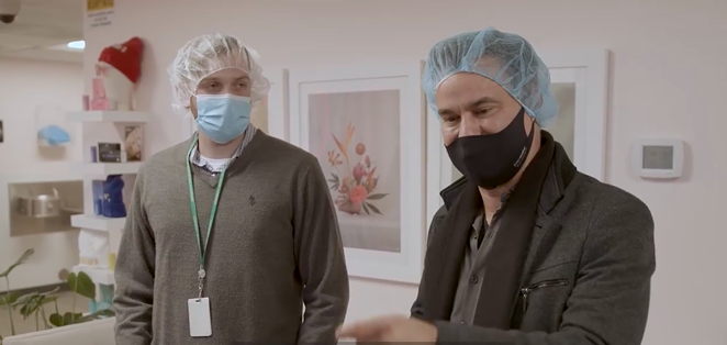 State Sen. Roland Gutierrez (right) tours a marijuana products facility in Colorado in his new, self-financed documentary. - SCREEN CAPTURE / LEGALIZE TEXAS YOUTUBE CHANNEL