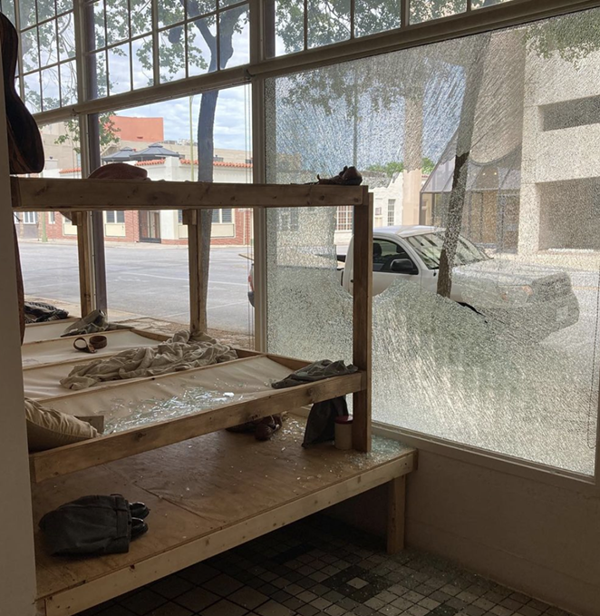 A photo taken from inside Artpace shows the building's shattered window. - INSTAGRAM / JOSEVILLALOBOSART