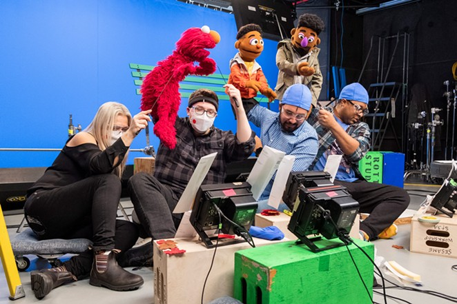 Bradley Freeman Jr. (second from right) controls the  Wesley Walker Muppet during a shoot for a Sesame Street online series. - SESAME WORKSHOP