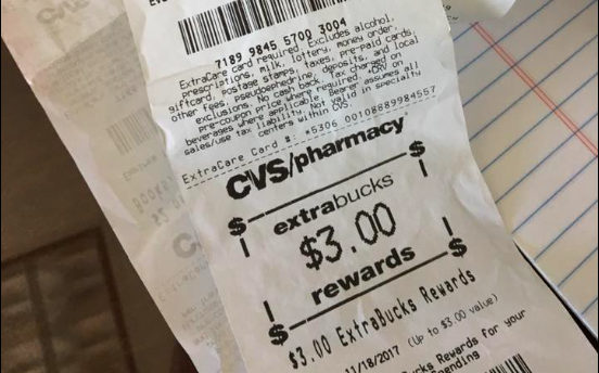 This mile-long CVS receipt dug from a Health and Human Services Commission employee's desk drawer will be given to a lucky Texan without health coverage. - FACEBOOK / RONNIE DAHL