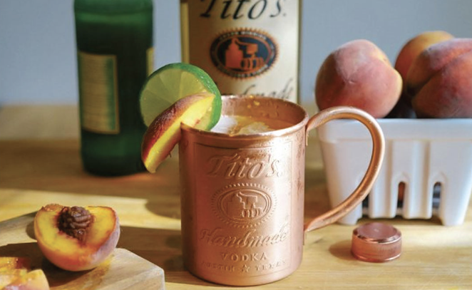 Peach-infused Tito's Vodka and Ginger Beer complete Twin Liquors' Peach Mule cocktail combo. - INSTAGRAM / TWINLIQUORS