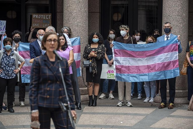 People held up a transgender flag earlier this month at an Equality Texas event at the Capitol. - SERGIO FLORES / THE TEXAS TRIBUNE