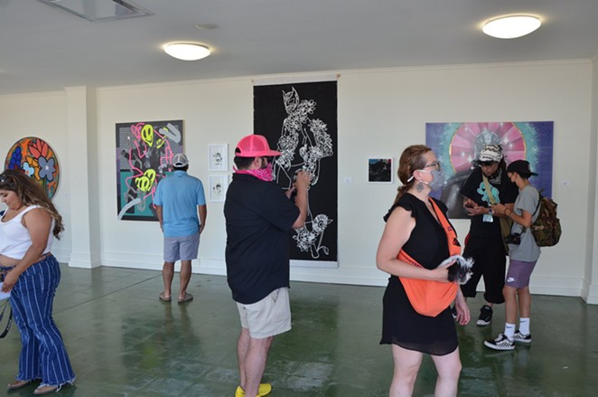 "PBR Studios hosts a group exhibit showcasing ""The Mural Connection"" artists. - BRYAN RINDFUSS"