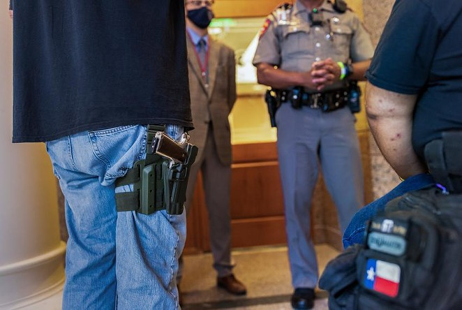 Two gun rights activists argue with a state trooper who will not allow them to enter an overflow room due to COVID-related restrictions at the Capitol on April 29, 2021. - TEXAS TRIBUNE / JORDAN VONDERHAAR