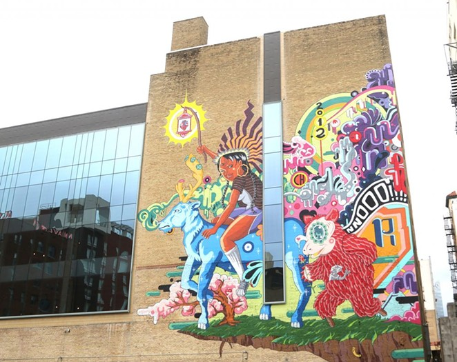"""""""The Last Parade"""" is on display on the side of the Kress building. - SAN ANTONIO HERON / BEN OLIVO"""