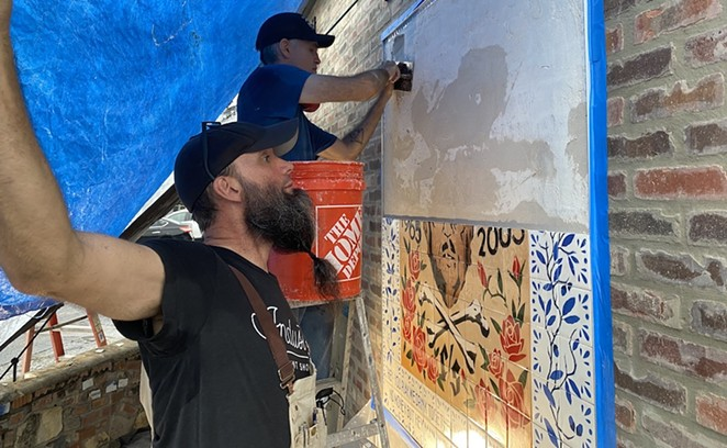 Matt Simpson spreads thin-set onto the wall of Velvet Taco while Mig Kokinda figures out which hand-stenciled tiles go on next. - SANFORD NOWLIN