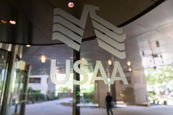 USAA's logo is emblazoned on a window of its sprawling corporate campus. - TWITTER / USAA