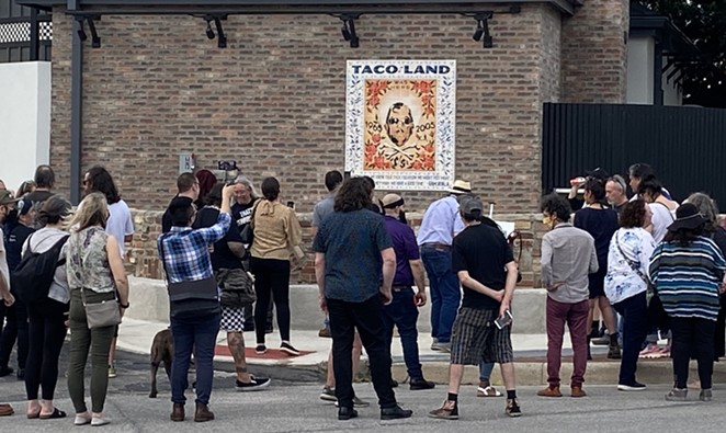 Taco Land regulars gather around a mosaic honoring the club's owner, the late Ram Ayala, on Thursday evening. - SANFORD NOWLIN