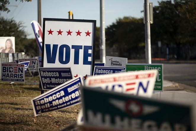 Voting signs at Dan Ruiz Branch Library in Austin on Election Day 2020. - TEXAS TRIBUNE / MIGUEL GUTIERREZ JR.