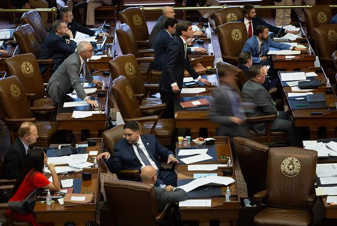 Members of the House move to vote at their desks on the House floor at the state Capitol on May 28, 2021. - TEXAS TRIBUNE / EVAN L'ROY