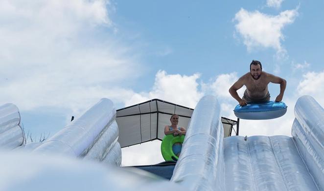 Summer Splash LLC is bringing its Slide the Slopes event to the Lone Star State. - INSTAGRAM / SLIDETHESLOPES