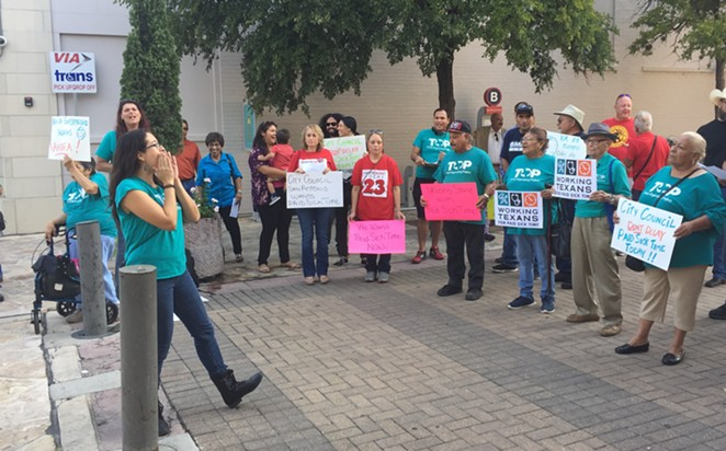Activist Joleen Garcia leads paid sick time advocates outside the chambers of San Antonio City Council. Council voted to approve the ordinance in 2018, but it's been contested in court. - SANFORD NOWLIN