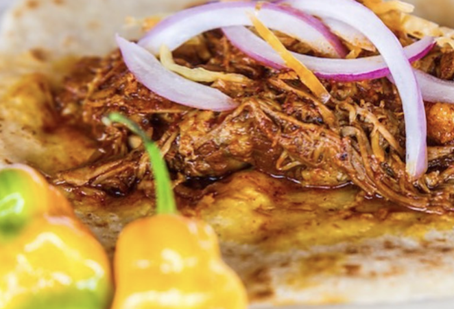 Tacos' Cochinita pibil with pickled onions are one of the menu items at Chela's. - INSTAGRAM / CHELASTACOS