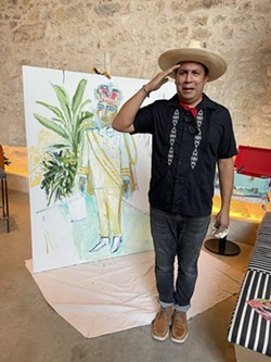 Cruz Ortiz poses in front of the completed portrait of Thomas Aguillon. - PHOTO COURTESY CANOPY BY HILTON SAN ANTONIO RIVERWALK