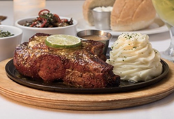 Perry's three-course Pork Chop SundaySupper. - INSTAGRAM / PERRYSSTEAKHOUSE