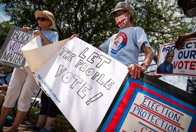 Louise Calvillo and Charolette Connelly, members of the Texas Alliance for Retired Americans, protest against Republicans' proposed voting restrictions in Richardson. - TEXAS TRIBUNE / BEN TORRES