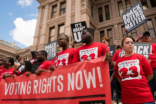 Individuals stand on the south steps of the Texas Capitol in support of voting rights at a press conference organized by Black Voters Matter, the Texas Right to Vote Coalition, Texas for All Coalition and other advocacy groups on July 8, 2021. - SOPHIE PARK / TEXAS TRIBUNE
